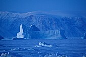 Frozen iceberg in the ocean at Qaanaaq, Northwest Greenland, Greenland