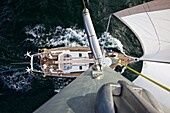 Sailing boat, yacht seen from above with trade wind sails during the Atlantic crossing