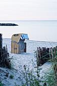 Roofed wicker beach chair at Baltic Sea beach, Schönberger Strand, Probstei, Schleswig-Holstein, Germany