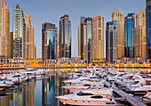 Yachts in the harbour at Dubai Marina and skyscrapers, Dubai, Unites Arab Emirates, UAE