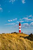 Lighthouse in the dunes, Amrum Island, North Frisian Islands, Schleswig-Holstein, Germany