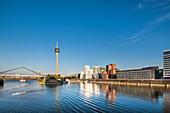 Frank Gehry buildings and television tower, Neuer Zollhof, Media harbour, Duesseldorf, North Rhine Westphalia, Germany