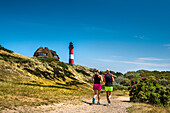 Jogger in front of lighthouse, Hoernum, Sylt Island, North Frisian Islands, Schleswig-Holstein, Germany