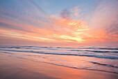 Sunrise at Trabucador beach in Punta de la Banya o dels Alfacs, Natural Park of Delta de l'Ebre, Tarragona, Spain.