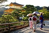 Japanese women with Kimono, Kinkakuji Temple, The Golden Pavilion, Rokuon-ji temple, Kyoto, Japan.