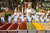 A vendor sells a large selection of Fresh ground spices in Tel Avivs Carmel Market.