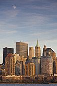 USA, New York, New York City, lower Manhattan skyline from Jersey City, late afternoon with moonrise.