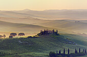 Typical Tuscan farmhouse with cypress trees, Val d'Orcia, Orcia Valley, Tuscany Landscape, UNESCO world heritage site, San Quirico d'Orcia, Siena Province, Tuscany, Italy.