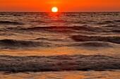 Gulf beach and surf after sunset