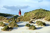 Lighthouse behind sand dunes, Amrum, North Frisian islands, Schleswig-Holstein, Germany, Europe.