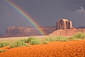 Rainbows end in Monument Valley, Navajo Nation, USA