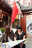 Tourists watching a map at Yu Yuan Garden, Huangpu District, Shanghai, China, Asia  MR