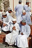 Oman, Al-Dakhiliyah, Nizwa, souq, group of men