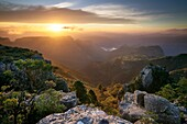 Landscape photo of a dramatic sunset over Blyde River Canyon, viewed from the Mariepskop side. Mpumalanga, South Africa.