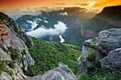 Landscape photo of a colourful sunrise over the depths of Blyde River Canyon. Mpumalanga, South Africa.