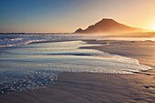 Landscape photo of a colourful sunset on a beach. Bettys Bay, Western Cape, South Africa.
