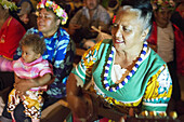Atiu Island. Cook Island. Polynesia. South Pacific Ocean. People dressed in traditional Polynesian dances and interpret Polynesian dances organized at Hotel Villas Atiu Atiu island. The Cook Islands lie northeast of New Zealand in the South Pacific Ocean.
