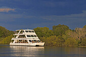 Cruise along the Victoria Falls aboard the  African Queen. Other boats sailing in the Zambezi River. This is the Lady Livingstone? boat. The newly built lady Livingstone famously known as The Jewel of the Zambezi has a capacity of 144 pax. Guests are met