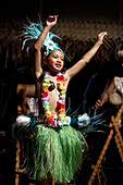 Rarotonga Island. Cook Island. Polynesia. South Pacific Ocean. Highland Paradise Cultural Village. A girl dressed in traditional cook island costumes dance during the Highland Paradise Cultural Village show. This 600 year old village site was home to the