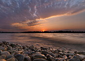 Pebble stones at beach at sunset, Fraueninsel, lake Chiemsee, Bavaria, Germany