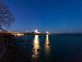 Shipping pier at night, Fraueninsel, lake Chiemsee, Bavaria, Germany