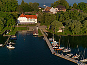 Aerial shot of Hotel Restaurant Inselwirt, Fraueninsel, lake Chiemsee, Bavaria, Germany