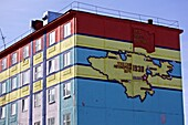 coloured apartment house with a map of the establishment of the Chukotka Autonomous Okrug, Anadyr, Chukotka Autonomous Okrug, Siberia, Russia