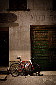 Bicycle leaning against an old house, Furkapass, Canton Uri and Wallis, Switzerland