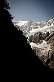 Hiker on mountain trail, on the way to Schreckhorn hut, Lower Grindelwald glacier, Bernese Oberland, Switzerland