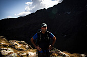 Hiker, ascent to Bremer Hut (2413 m), rear of Gschnitz Valley, Stubai Alps, Tyrol, Austria