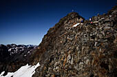 Two hikers climbing over boulder field, ascend to Habicht (3277 m), Stubai Alps, Tyrol, Austria