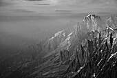 High mountains in the mist, Mont Blanc Mountain Massif, Graian Alps, France