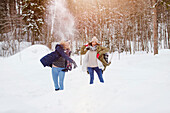 Two young women throwing snowballs, Spitzingsee, Upper Bavaria, Germany