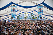 Germany, Bavaria, Munich, Oktoberfest, People in Bavarian Costume inside Beer Tent