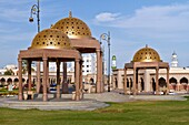 Golden domed cupolas on the harbourfront of Muscat, Oman.