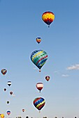 Hot Air Balloons against bright blue sky, low angle view