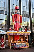Market stall with a large nutcracker at the christmas market in Bremen, Germany, Europe