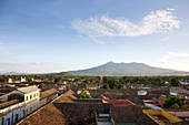 Rooftop view of Granada, Nicaragua with the Mombacho Volcano looming in the background