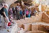 Cortez, Colorado - A park ranger talks with visitors to the Long House cliff dwelling in Mesa Verde National Park  The park features cliff dwellings of ancestral Puebloans that are nearly a thousand years old