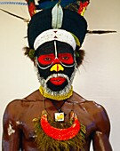 Peke Dupio from Map Village Southern Highlands of Papua New Guinea wearing a Christian emblem around his neck
