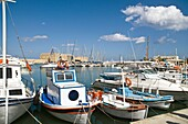 IRAKLIO GREECE CRETE Cretan boat moored Heraklion harbour and Venetian fortress Koules Castle