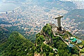 Christ the Redeemer on Corcovado Mountain, Rio de Janeiro Brazil South America The statue stands 38 m 125 feet tall and is located at the peak of the 710-m 2330-foot Corcovado mountain in the Tijuca Forest National Park, overlooking the city  As well as b