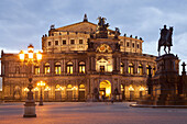 opera house Semperoper and Statue Of King Johann on Theater square in Dresden at night, Saxony, Germany, Europe.