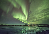 Aurora Borealis or northern Lights during winter at southern Iceland.