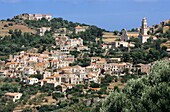 Quaint townscape and hills, Corbara, Corsica, France.