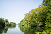 canoeing along the Wakenitz river, along the former German border between East and West, area so called Amazona of the North, Schleswig-Holstein, Germany