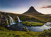 Kirkjufell mountain and waterfall Snaefelness Peninsula dramatic sunset prime tourist destination Iceland