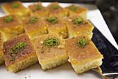 Revani, turkish dessert consisting of a mixture of semolina, wheat flour, eggs, sugar, oil, yogurt and lemon at the pastry shop, Taksim, Istanbul, Marmara Province, Turkey, Europe.