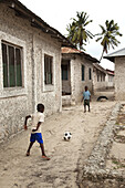 Children playing with the ball in the village, Jambiani, Zanzibar Island, Tanzania, Indian Ocean, East Africa.