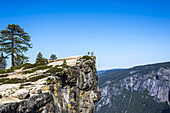 View of people at the Taft Point overlook. Yosemite National Park, CA, USA.